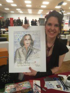 Live-Malerin Ute Spingler mit dem gerade entstandenen Unternehmer-Portrait von Klaus Rempe beim BVMW